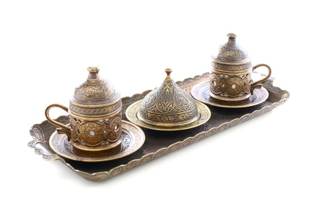 Bronze set for Turkish coffee on a white background  photo