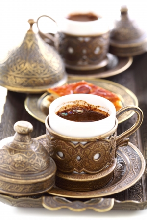 Bronze cup of Turkish coffee with a close-up  photo