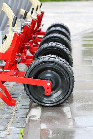 seeding: Wheels seeding system at the site in the rain. Stock Photo