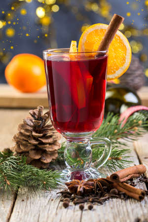 mulled wine spice: Hot drink of wine and spices in glass on old table. Stock Photo
