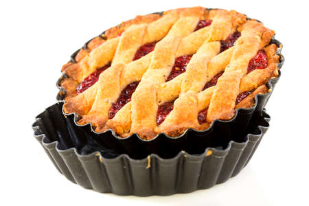 nonstick: Cake with raspberry jam in the form of non-stick coating on a white background. Stock Photo