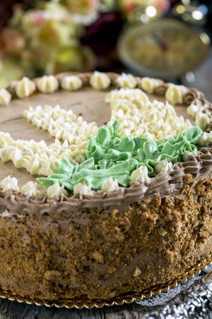 chocolaty: Festive nut cake with butter cream close up.