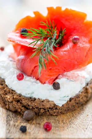 red salmon: Sandwich with red salmon, cheese and dill close up.