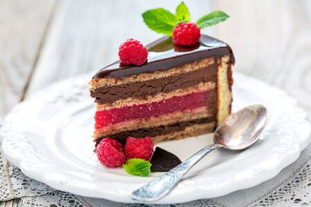 raspberry jelly: Piece of cake with raspberry jelly on dessert plate.