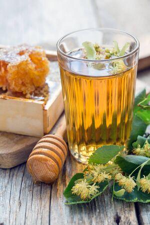 linden tea: Linden tea and honey on an old table.