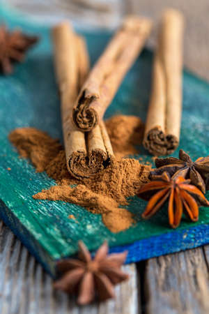 star anise christmas: Cinnamon and star anise - Christmas spices on an old wooden table. Stock Photo
