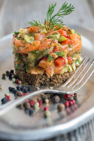 Tartar of salted salmon and capers close-up. Stock Photo