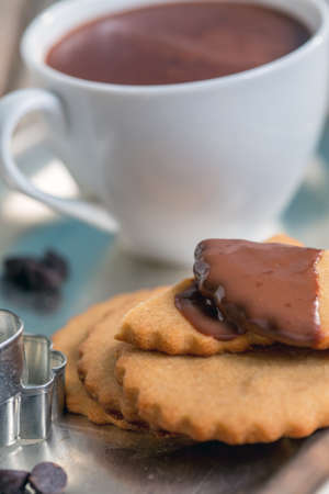 shortbread: Shortbread cookies and hot chocolate on a metal tray. Stock Photo