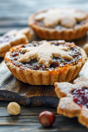 Cakes with dried fruit and nuts on wooden table, selective focus. Stock Photo