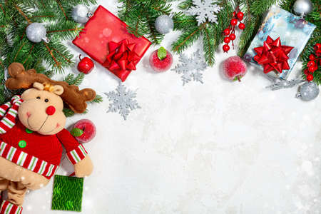 Pills, medical masks, gifts, a branch of a fir tree in a shopping cart on a blue background. Creative concept of the New year against the background of coronavirus. Stock Photo