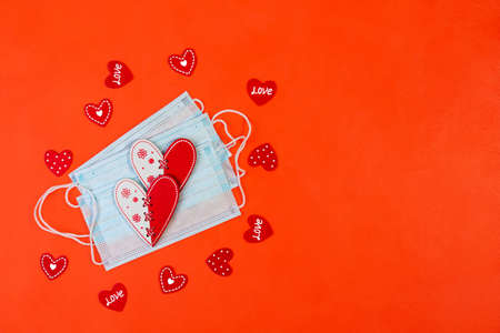 Red and white hearts and small Valentines on a red background with a copy space. Top view, flat lay. Stock Photo