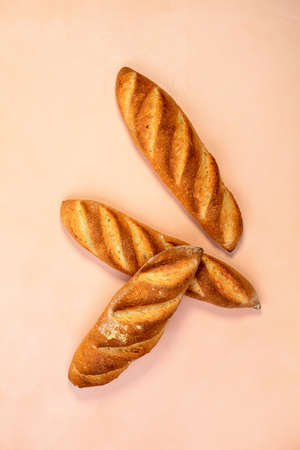 Baguette flies in the air.Traditional French baguette with sourdough. Cut the freshly baked bread into slices. Stock Photo