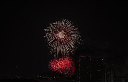 Colorful fireworks display over city . Firework celebration sparkling in midnight sky, countdown , khonkaen, Thailand 스톡 콘텐츠