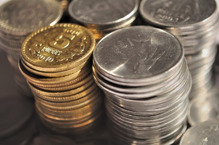 Stack of Indian currency coins of denomination Rs.5, Rs.2 and Re.1