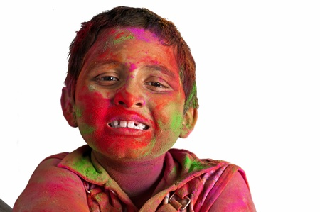 Close up face of young boy playing Holi, smiling with colors on face Stock Photo - 13004307