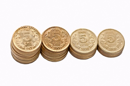 Close up of Indian Coin stack, 5 rupees, isolated on white background, copy space, Stock Photo