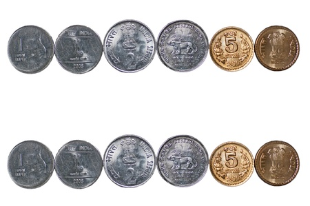 Close up of  2 rows of Indian Coins, 5 rupees, 2 rupees, 1 rupee, isolated on white background, copy space,