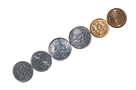 Closeup of  a row of Indian Coins, placed diagonally, 5 rupees, 2 rupees, 1 rupee, isolated on white background, copy space,