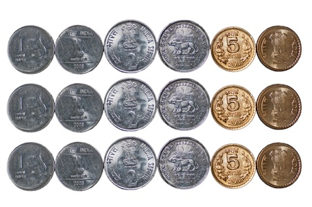 Close up of  3 rows of Indian currency, Coins, 5 rupees, 2 rupees, 1 rupee, isolated on white background, copy space,