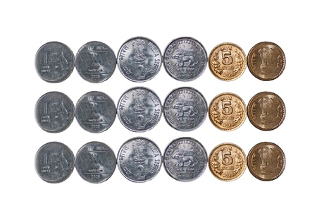 Close up of  3 rows of Indian currency, Coins, 5 rupees, 2 rupees, 1 rupee, isolated on white background, extra copy space, photo
