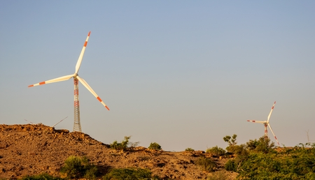 Electricity generating windmills in Indian Thar desert photo