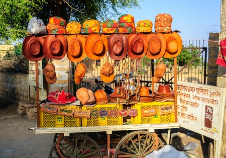 Different types of hats and caps displayed for sale, roadside vendor, Jaisalmer, Rajasthan, India
