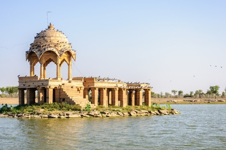 Ancient hindu stone temple in the middle of Gadisar lake, Jaisalmer, Rajasthan Stock Photo