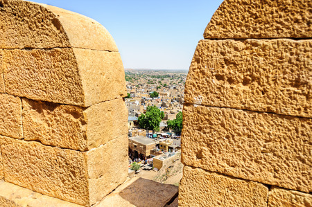 Birds eye view of Jaisalmer city through parapet ofGolden Fort of Jaisalmer, Rajasthan India