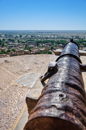 jaisalmer: Ancient iron cannon of Golden Fort of Jaisalmer, Rajasthan India facing Jaisalmer city with copy space