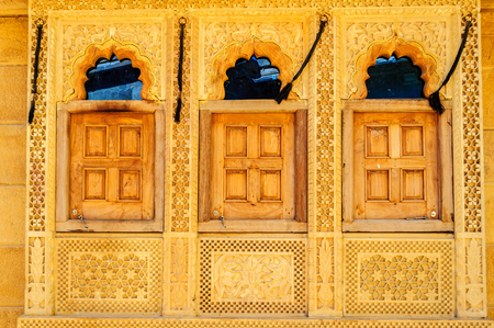 Threee traditional windows and pattern of Golden Fort of Jaisalmer, Rajasthan India with copy space