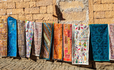 Handloom traditional and colorful clothes hanging Golden Fort of Jaisalmer, Rajasthan India with copy space