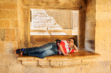 Young tourist, Bengali boy resting inside the museum of Golden Fort Rajasthan, India with copy space Editorial