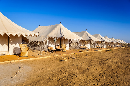 A number of white tents in Indian Thar desert, Desert national Park, blue sky, yellow sand, daylight, copy space Stock Photo