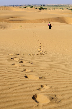 Footprints of a young boy on Sand dunes, SAM dunes of Thar Desert of India with copy space Stock Photo
