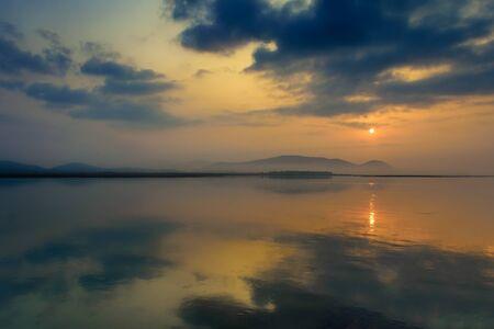 Sunrise over Mahanadi river, Odisha, Eastern Ghat mountain range, copy space