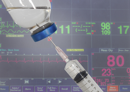 Syringes and vital signs Blurry monitor 写真素材