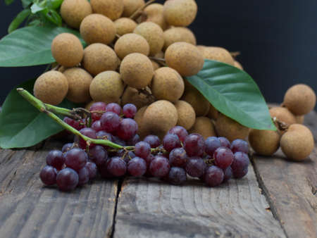 Lots of longan fruit on the wooden table.
