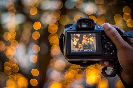 DSLR Camera on Bokeh Background - Black DSLR Camera With Bokeh Lights Photo and Camera City Lights Bokeh