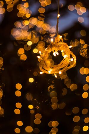 Bokeh Tree Light Decoration - Welcoming House and the fabulous party and Christmas night - Outdoor Trees have been decorated with yellow lights