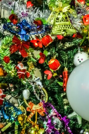 Christmas tree on living room. Beautiful holiday decorated room with Christmas tree with toys.