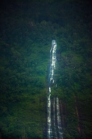 unexpected water fall on the mountain of western ghats at rainfall in valparai, india.