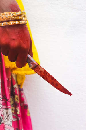 Woman killed serial rapist on bloody knife for her self defense to protect herself from rapist person.