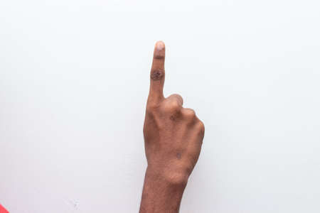 Boy hand showing number one gesture symbol isolated on white background. Gesturing number 1. Number one in sign language. counting down One concept. One fingers up. man hand sign victory gesture.