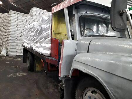 Ten wheel truck loading sack goods to customers.