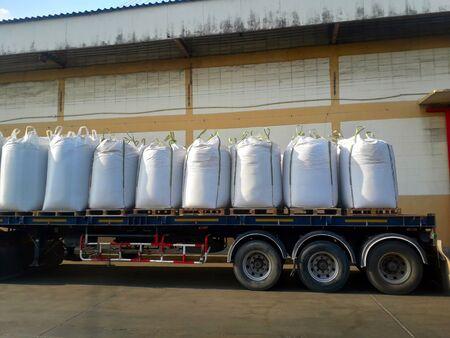 Trailer loading goods fertilizer urea sack jumbo to customers.