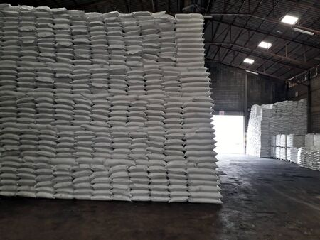 Chemical fertilizer The product stock is packed in sacks, stacked in the warehouse, waiting for delivery. 写真素材