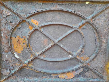The old iron background is rusty, dark brown from use for a long time is damaged.