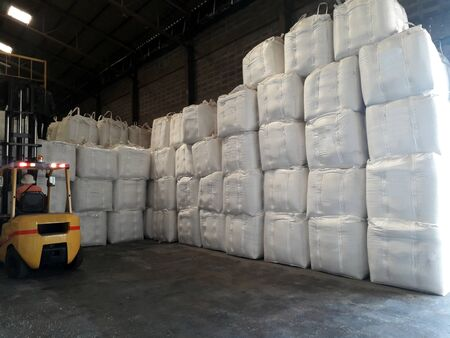 Chemical fertilizer Urea Stockpile jumbo-bag in warehouse waiting for shipment.