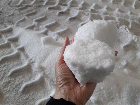 Urea chemical fertilizer, white foam granules, agglomerate In the hands of farmers Stock Photo
