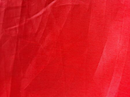 Red background fabric Swaying like a silk thread when hit by the wind.